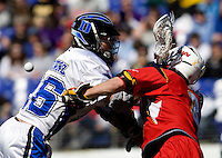 Robert Rotanz (26) of Duke collides with Jake Bernhardt  (3) of Maryland as the ball is knocked loose during the Face-Off Classic in at M&T Stadium in Baltimore, MD