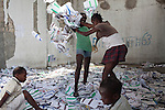 Children play in ballots at a polling station that had been ransacked on the previous day during presidential and legislative elections on Monday, November 29, 2010 in Port-au-Prince, Haiti.
