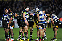 The Bath Rugby forwards huddle together late in the match. Aviva Premiership match, between Bath Rugby and Gloucester Rugby on February 5, 2016 at the Recreation Ground in Bath, England. Photo by: Patrick Khachfe / Onside Images