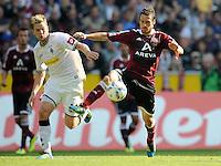 FUSSBALL   1. BUNDESLIGA   SAISON 2011/2012    7. SPIELTAG Borussia Moenchengladbach - 1. FC Nuernberg         24.09.2011 Thorben MARX (li, Moenchengladbach) gegen Markus FEULNER (re, Nuernberg)