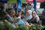 People shop for vegetables in the market in the Al-Shalti refugee camp in Gaza. Residents of the Palestinian territory are still reeling from the death and destruction of the 2014 war with Israel, and the continuing siege of the seaside territory by the Israeli military.