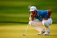 Dustin Johnson lines up his putt on the 11th green during the 2016 U.S. Open in Oakmont, Pennsylvania on June 18, 2016. (Photo by Jared Wickerham / DKPS)