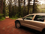 Volvo XC70 Car on an unpaved road in a stormy misty weather the nature