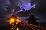 An early morning shower off the coast of Naples provides a lighting show for fisherman on Naples Pier Thursday morning. Scattered thunderstorms have been predicted for the rest of the day in Southwest Florida.Erik Kellar/Staff