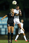 09 October 2014: North Carolina's Joanna Boyles (right) and Wake Forest's Claudia Day (left). The University of North Carolina Tar Heels hosted the Wake Forest University Demon Deacons at Fetzer Field in Chapel Hill, NC in a 2014 NCAA Division I Women's Soccer match. UNC won the game 3-0.