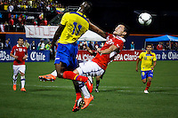 Ecuador's player Cristian Benitez ( L) fights for the ball against Chile's player Marco Gonzalez during their friendly match at the Citi-Field Stadium in New York, August 15, 2012. Photo by Eduardo Munoz Alvarez / VIEW.