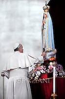 Pope Francis prays in front of Our Lady of Fatima in St. Peter's square October 12, 2013