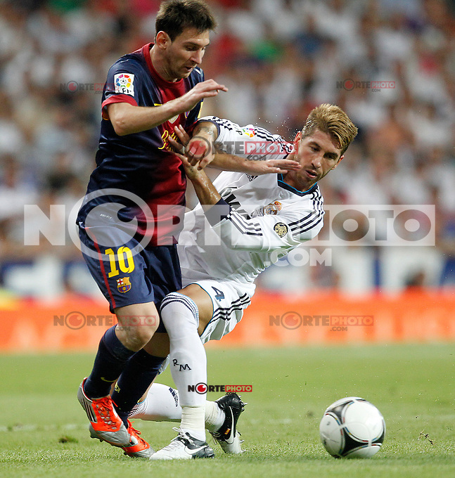 Real Madrid's Sergio Ramos and F.C. Barcelona's Lionel Messi during Spanish Supercup 2nd match on august 29 2012...Photo: Cesar Cebolla / ALFAQUI /NortePhoto.com<br />
