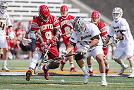 Towson, MD - March 25, 2017: Denver Pioneers Trevor Baptiste (9) and Towson Tigers Alex Woodall (41) fights for the ground ball during game between Towson and Denver at  Minnegan Field at Johnny Unitas Stadium  in Towson, MD. March 25, 2017.  (Photo by Elliott Brown/Media Images International)