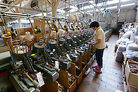 Weaving denim cloth. Nihon Menpu, Ibara City, Okayama Prefecture, Japan, July 10, 2013. Kojima is the birthplace of Japanese denim and famous for artisan jeans. The area's textile industry is based on advanced dyeing and weaving technology that has it's roots in pre-industrial indigo dyeing.