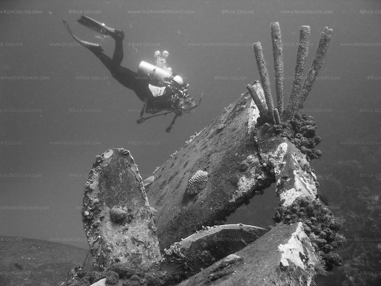 """Diving Bonaire, Netherland Antilles -- A diver swims past the propeller and rudder of the """"Hilma Hooker.""""  (""""Hilma Hooker"""" dive site)."""