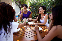 Members of the 'Me N Ma Girls', Myanmar's first girl band, eat a meal during a break from filming the video for their next release. The band's members were recruited by Australian dancer Nicole May. They sing and dance in the manner of many Western pop acts but in socially conservative Myanmar, they represent a radical break from the norm.
