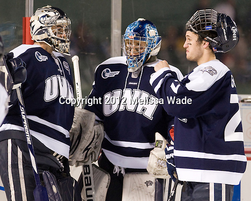 Tyler Scott (UNH - 1), Casey DeSmith (UNH - 29), Kevin Goumas (UNH - 27) - The University of Maine Black Bears defeated the University of New Hampshire Wildcats 5-4 in overtime on Saturday, January 7, 2012, at Fenway Park in Boston, Massachusetts.