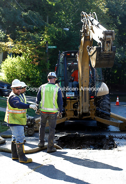 Waterbury, CT- 19 September 2014-091914CM02-  Crews from the Waterbury Bureau of Water investigate a water main break on Bonair Ave in Waterbury on Friday.  The crews cut a section of asphalt near the intersection of Melbourne Terrace to determine the cause of the rupture.    Christopher Massa Republican-American
