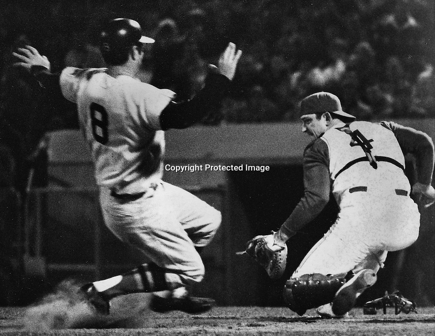A's catcher Phil Roof wheels in time to tag out Carl Yastrzemski at the plate. (1969 photo by Ron Riesterer)