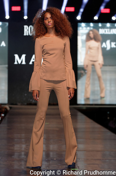 A model poses on the runway during the Maska fashion show held during the Fashion and Design Festival  in downtown Montreal.