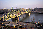 Budapest, Hungary. Gellert Bridge over the Danube at dusk with tram in foreground.