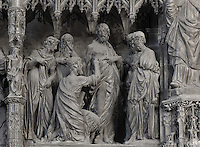 The apostle Thomas puts his fingers in Christ's wound, not believing in his resurrection. Doubting Thomas, by Thomas Boudin, 1611-12, from the choir screen, Chartres Cathedral, Eure-et-Loir, France. Chartres cathedral was built 1194-1250 and is a fine example of Gothic architecture. It was declared a UNESCO World Heritage Site in 1979. Picture by Manuel Cohen.