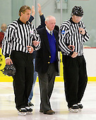 Todd Whittemore and Brett Reed escort former Army hockey coach Jack Riley onto the ice for a ceremonial puck drop. - The host Colgate University Raiders defeated the Army Black Knights 3-1 in the first Cape Cod Classic on Saturday, October 9, 2010, at the Hyannis Youth and Community Center in Hyannis, MA.