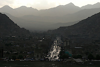 Kabul at dusk. Main street with much traffic.