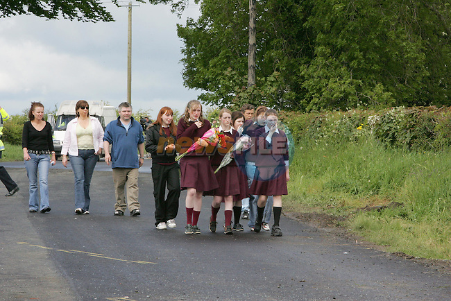 Students and friends lay flowers at the scene of the fatal bus accident outside Kentstown Co Meath..Photo NEWSFILE/FRAN CAFFREY..(Photo credit should read FRAN CAFFREY/NEWSFILE)...This Picture has been sent you under the condtions enclosed by:.Newsfile Ltd..the Studio,.Millmount Abbey,.Drogheda,.Co Meath..Ireland..Tel: +353(0)41-9871240.Fax: +353(0)41-9871260.GSM: +353(0)86-2500958.email: pictures@newsfile.ie.www.newsfile.ie.FTP: 193.120.102.198..This picture is from Fran Caffrey@newsfile.ie