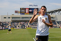 Sebastien Le Toux (9) of the Philadelphia Union waves to fans as he leaves the field at the end of warm-ups. The Philadelphia Union defeated Toronto FC 2-1 on a second half stoppage time goal during a Major League Soccer (MLS) match at PPL Park in Chester, PA, on July 17, 2010.