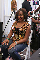 T3 Micro hairstylist, style woman's hair, at the Makeup Show NYC, in the Metropolitan Pavilion, May 15 2011.