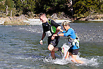 NELSON LAKES, NEW ZEALAND - APRIL 18:  Don MacKenzie and  Alison Scobie cross the Travers River during the 2015 Alpine Lodge Loop The Lake trail run at Lake Rotoiti on April 18 16, 2015 in Nelson, New Zealand. (Photo by Marc Palmano/Shuttersport Limited)