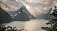 Milford Sound with Mitre Peak with dramatic skies before sunset, Fiordland National Park, Southland, UNESCO World Heritage Area, New Zealand, NZ