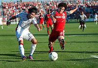 23 June 2011: New England Revolution midfielder/forward Lee Nguyen #24 and Toronto FC defender Logan Emory #2 in action during an MLS game between the New England Revolution and the Toronto FC at BMO Field in Toronto..The game ended in a 2-2 draw.