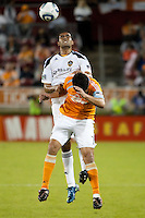 Luis Angel Landin of the Houston Dynamo and Leonardo of the Los Angeles Galaxy fight for the header during the regular season game between the Los Angeles Galaxy and the Houston Dynamo at Robertson Stadium in Houston, TX on April 10, 2010. Los Angeles 2, Houston 0.