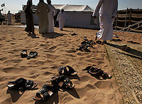 As with tradition, sandals are removed before entering the tents of the Mohamed Khamisi compound.