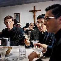 Young priests have a meal together at the Legionaries of Christ seminary in Salamanca. The Legion of Christ is a conservative Roman Catholic congregation whose members take vows of chastity, obedience and poverty.