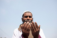 Bangladeshi Muslim man prays on the last day of World Congregation of Muslims, or Biswa Ijtema, on the banks of the River Turag just outside  Dhaka, Bangladesh. Jan 11, 2015