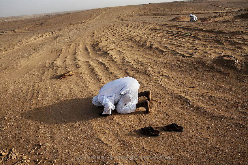 Muslims pray in the Nubian desert, south of Dongola, Sudan, on Sunday, March 25, 2007. Sudan is approximately  70% Muslim.