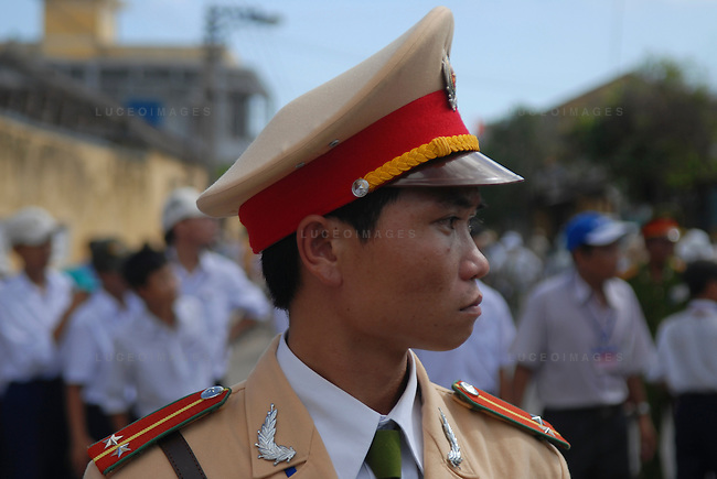 A Vietnamese military officer watches over a parade in Hoi An, Vietnam.
