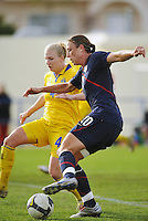 Abby Wambach attacks the goal in a game vs Sweden in Ferreiras, Portugal on March 1, 2010 during the Algarve Cup.