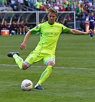 Seattle Sounders FC defender Jeff Parke clears the ball during play against Manchester United at CenturyLink Field in Seattle Wednesday July 20, 2011. Manchester United won the match 7-0.