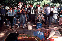 NYPD officers evict the homeless and other squatters from Tompkins Square park in the East Village on June 3, 1991. (© Richard B. Levine)