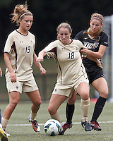 Boston College midfielder Patrice Vettori (18) dribbles as University of Central Florida forward/midfielder Jennifer Martin (5) defends. After two overtime periods, Boston College tied University of Central Florida, 2-2, at Newton Campus Field, September 9, 2012.