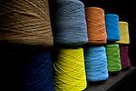 Spools of dyed alpaca wool fibers at an alpaca wool factory in El Alto, Bolivia.