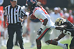 Ole Miss' Ja-Mes Logan (85) is tackled by Vanderbilt defensive back Eddie Foster (16) in Nashville, Tenn. on Saturday, September 17, 2011. Vanderbilt won 30-7..