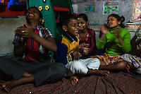 Students close their eyes and clap in a therapeutic meditation practice Santwana Manju does every evening in the Boat School she runs on the holy Ganges River, in Varanasi, Uttar Pradesh, India on 11 November 2013. The school aims to take the boatmen's children away from working in the tourist areas where they are exposed to trafficking and sexual abuse.