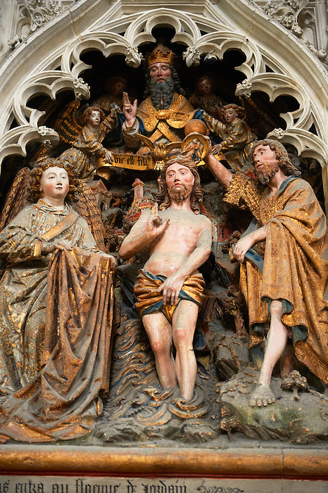 Gothic sculptures depicting  John The Baptist baptsisng Christ. Cathedral of Notre-Dame, Amiens, France.
