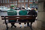 Hibernian 3 Alloa Athletic 0, 12/09/2015. Easter Road stadium, Scottish Championship. Three home fans sitting on a bench outside the West Stand at Easter Road stadium before the Scottish Championship match between Hibernian and visitors Alloa Athletic. The home team won the game by 3-0, watched by a crowd of 7,774. It was the Edinburgh club's second season in the second tier of Scottish football following their relegation from the Premiership in 2013-14. Photo by Colin McPherson.