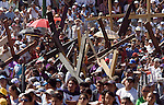 Thousands of people look at Jesus Christ cruxified by Roman soldiers during the Via Crucis in the neighborhood of Iztapalapa, April 14, 2006. Almost a million people attend the procession of Good Friday in this  neighborhood of Mexico City, where for 163 years the Iztapalapa neighborhood residents have taken part in a re-enactment of Christ's crucifixion.  Photo by © Javier Rodriguez