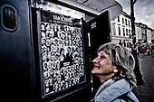 Warsaw 12/04/2010 Poland<br /> People mourning the tragic death of President Lech Kaczynski and his wife.<br /> on pictures: a poster with pictures of all the victims of the tragedy in Smolensk<br /> Photo: Adam Lach / Napo Images for The New York Times<br /> <br /> Zaloba po tragicznej smierci Prezydenta Lecha Kaczynskiego i jego malzonki.<br /> na zdjeciu: plakat ze zdjeciami wszystkich ofiar tragedii w Smolensku.<br /> Fot: Adam Lach / Napo Images for The New York Times