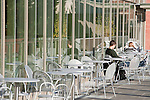 Students read outdoors on a fall day at Seattle University.