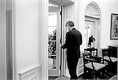 United States President Bill Clinton at the door from the Oval Office to the Colonnade at The White House in Washington, D.C. on Thursday, June 24, 1993..Credit: White House via CNP