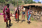 Africa, Kenya, Maasai Mara. Maasai of the Mara teach westerner how to build a boma home.